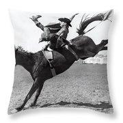 Riding A Bucking Bronco Throw Pillow