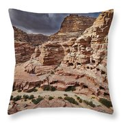 rock landscape with simple tombs in Petra Throw Pillow