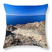 rocky coast in San Pietro island Throw Pillow