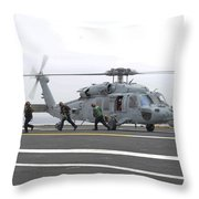 Sailors Leave The Landing Area Of An Throw Pillow