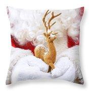 Santa Holding Reindeer Figure Throw Pillow
