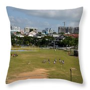 Schoolchildren Practicing On Playing Field With Singapore Skyline In Background Throw Pillow