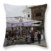 Seated Devotees Inside The Golden Temple Throw Pillow