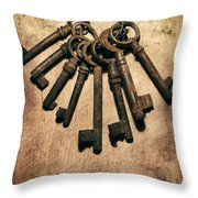 Set Of Old Rusty Keys On The Metal Surface Throw Pillow