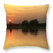 Setting Sun Glows Through Trees And Reflected In Still Lake Wate Throw Pillow