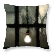 Lit Light Bulb Shines In Old Window Throw Pillow