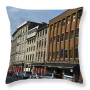 Shops And Buildings Along Rue Saint-paul Old Montreal Throw Pillow