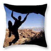 Silhouette Of A Rock Climber Throw Pillow