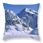 Skiers Cross Frozen Lake Harris Throw Pillow