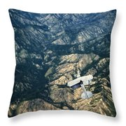 Small Plane Flying Over Mountains Throw Pillow