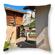 small street in Penia Throw Pillow