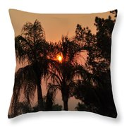 Smoke Covered Sky Sunset Thru The Palm Trees Throw Pillow