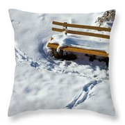 Snowy Foot Prints Around Snow Covered Park Bench Throw Pillow