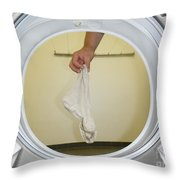 Sock In The Washing Machine Throw Pillow by Mats Silvan