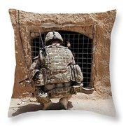 Soldier Searches A Compound Throw Pillow by Stocktrek Images