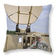 Soldier Stands Next To A Satellite Throw Pillow
