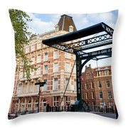 Staalstraat Bridge On Kloveniersburgwal Canal In Amsterdam Throw Pillow