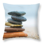 Stack Of Beach Stones On Sand Throw Pillow by Michal Bednarek