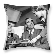 Stewardess Serving Food Throw Pillow by Underwood Archives
