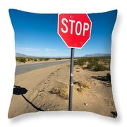 Stop Sign On Indian Ranch Road In Death Valley Throw Pillow