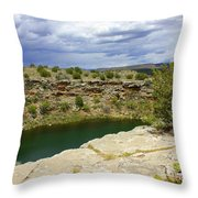 Storm Clouds Over Montezuma Well Throw Pillow