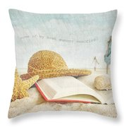 Straw Hat And Book In The Sand Throw Pillow by Sandra Cunningham
