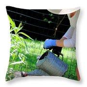 Straw Hat Gardener Throw Pillow