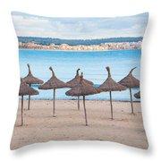 Straw Umbrellas On Empty Beach Throw Pillow