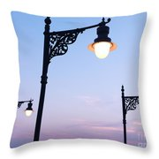 Street Lamps Over Sunset Sky Background Throw Pillow