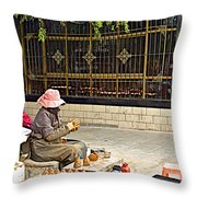 Street Shopkeeper In Lhasa-tibet Throw Pillow