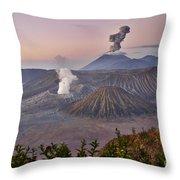 sunrise at vulcano Bromo with sea of sand vulcano Semeru with eruption Java Indonesia Throw Pillow