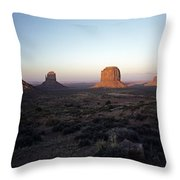 Sunset Light With Mittens And Desert In Monument Valley Arizona  Throw Pillow