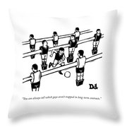 Table Soccer Players Look At One Unattached Throw Pillow