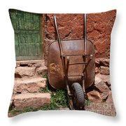 Rusty Wheelbarrow And Green Door Throw Pillow