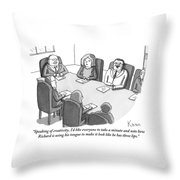The Boss At An Executive Meeting Points Out An Throw Pillow