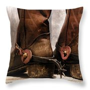 The Muddy Boots Throw Pillow by Olivier Le Queinec