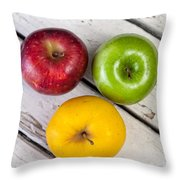 Thee Apples On A Table Throw Pillow