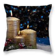 Three Gold Candles In Snow  Throw Pillow
