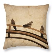 Three Pigeons Perched On A Metallic Arch. Throw Pillow
