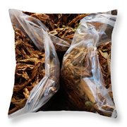 Top View Of Three Clear Bags Of Dried Throw Pillow
