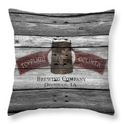 Toppling Goliath Throw Pillow
