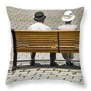 Two People Seated On A Bench Throw Pillow