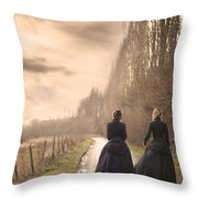Two Victorian Ladies Walking On A Cobbled Path Throw Pillow