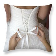 Tying The Bow On A Wedding Dress Throw Pillow