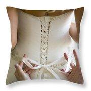 Tying The Wedding Dress Throw Pillow