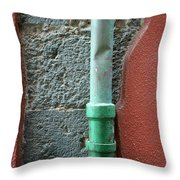 Vertical Drainpipe Against Colorful Throw Pillow