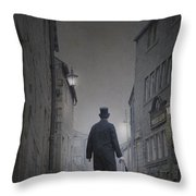 Victorian Man In Top Hat On A Cobbled Road At Night Throw Pillow