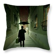 Victorian Man With Top Hat Carrying A Suitcase And Umbrella Walking In The Narrow Street At Night Throw Pillow