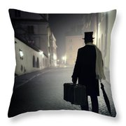Victorian Man With Top Hat Carrying A Suitcase Walking In The Old Town At Night Throw Pillow