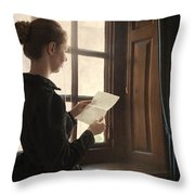 Victorian Or Edwardian Woman Reading A Letter By The Window Throw Pillow
